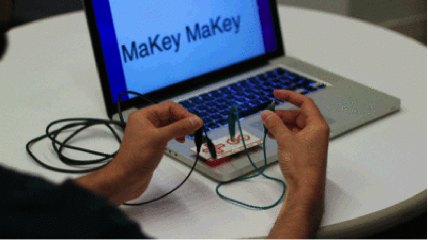 Makey Makey plugged into computer